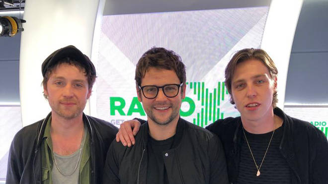 Catfish And The Bottlemen's Van McCann and Johnny Bond pose with Radio X's Gordon Smart