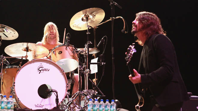 Taylor Hawkins and Dave Grohl of Foo Fighters perform at Hammerstein Ballroom on February 13, 2013