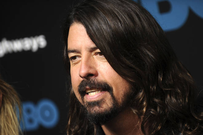 Dave Grohl attends the premiere of Foo Fighters 'Sonic Highways' at the Ed Sullivan Theater on October 14, 2014 in New York Cit