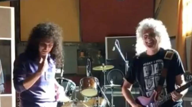 Screenshot of a video shared by Queen guitarist Brian May playing the solo to Bohemian Rhapsody on the set of the Bohemian Rhapsody film