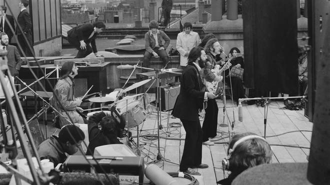 The Beatles performing their last live public concert on the rooftop of the Apple office in London
