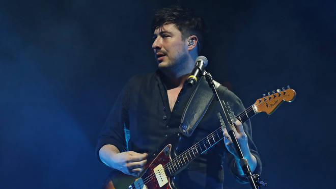 Marcus Mumford performs with Mumford and Sons in concert at TD Garden in Boston on 9 December 2018
