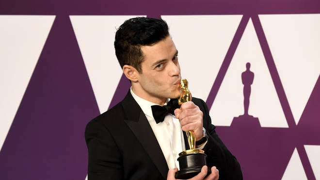 Rami Malek kisses his Best Actor Oscar Award for Queen Biopic Bohemian Rhapsody