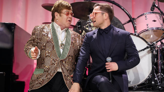 Elton John and Taron Egerton perform Tiny Dancer at his Oscars viewing party