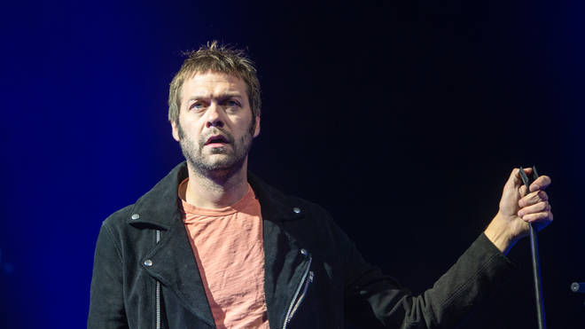 Kasabian's Tom Meighan on stage at Princes Street Gardens during Edinburgh Summer Sessions 2018