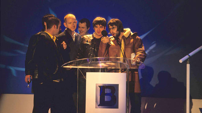 Alan McGee and Oasis at the BRIT awards in 1996