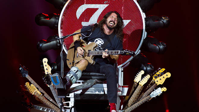 Dave Grohl plays with a broken leg in his specially made throne at Ziggodome, Amsterdam