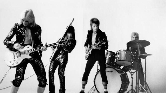 Guitarist Mick Ronson, bassist Trevor Bolder, David Bowie and drummer Mick Woodmansey of 'Ziggy Stardust And The Spiders From Mars' pose for a portrait in November 1972 in London, England