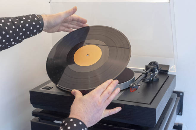 Putting a vinyl record on the turntable