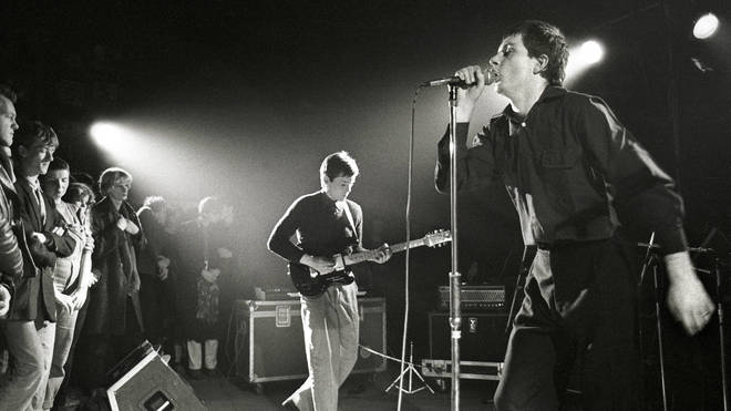 Ian Curtis performing live with Joy Division in the Netherlands in January 1980.