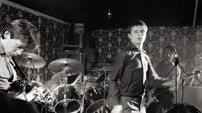 Joy Division: Bernard Sumner, Ian Curtis, Peter Hook performing live in 1979
