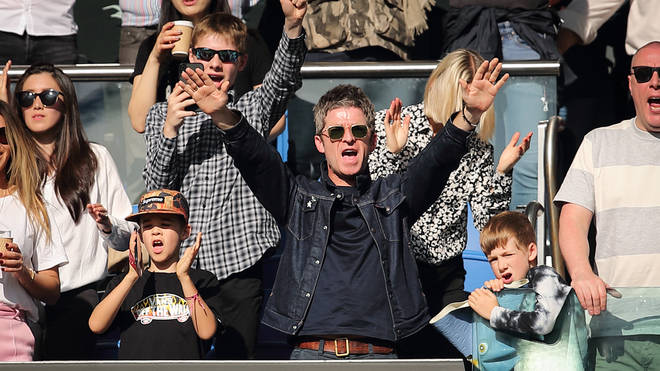 Noel Gallagher a fan of Manchester City,  celebrates becoming champions after the Premier League match between Brighton & Hove Albion and Manchester City