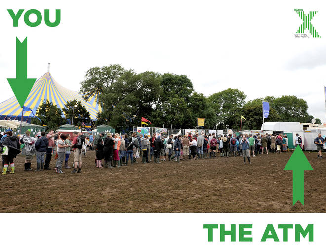 Festival goers queue for the ATMs at Glastonbury 2008