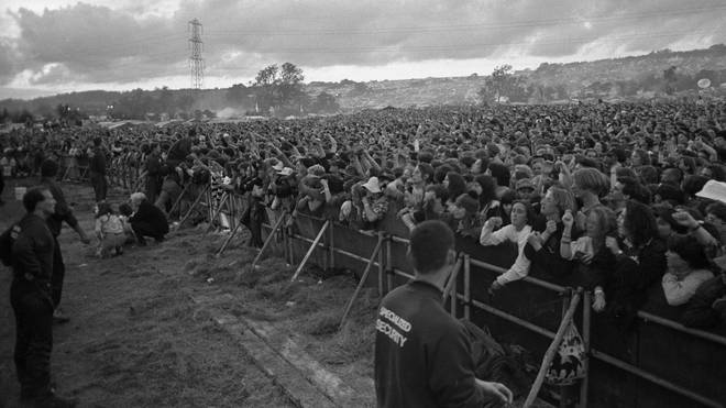 General view of the front rows of the crowd in front of the Pyramid Stage, Glastonbury Festival, United Kingdom, 1990.