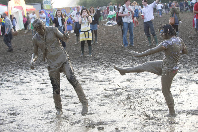 Fans enjoy mud baths on day 2 of Glastonbury Festival at Worthy Farm on June 26, 2009 in Glastonbury