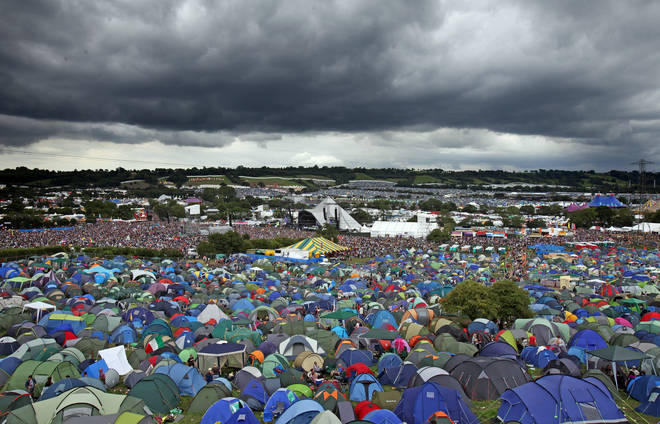 Rain clouds gather over the Pyramid Stage at the Glastonbury Festival site at Worthy Farm, Pilton on June 24, 2011