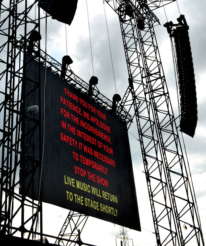 Bad weather signage on The Pyramid Stage as the stage is closed due to lightning on Day One of the Glastonbury Festival at Worthy Farm on June 27, 2014