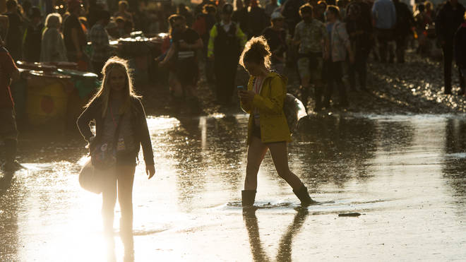 Festival goers brave the mud at Glastonbury Festival 2016 at Worthy Farm, Pilton on June 25, 2016