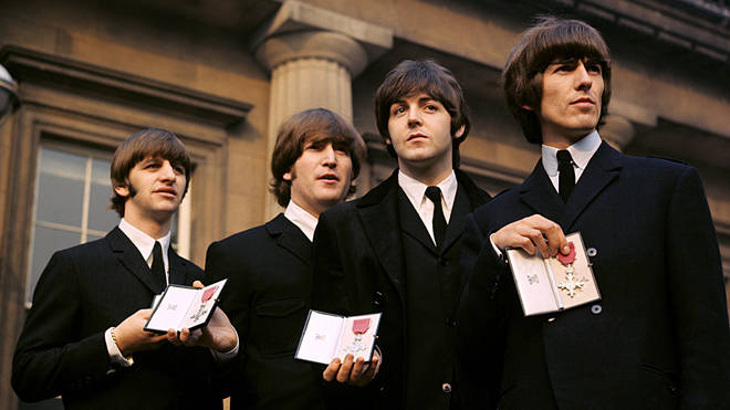 The Beatles receive their MBEs in 1965