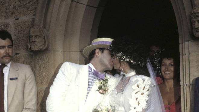 Elton John and ex-wife Renate kiss outside church on wedding day