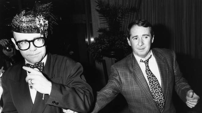 Elton John and manager John Reid at a party in 1988