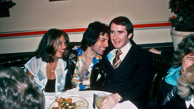 Freddie Mercury of Queen and John Reid at a party in March 1977