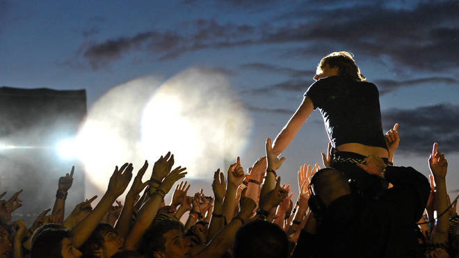 Ricky Wilson of Kaiser Chiefs performs on stage on Day 1 of Reading Festival 2009