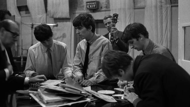 The Beatles sign documents for music publisher Dick James in Studio 2 at Abbey Road in London recording the single 'She Loves You', 1st July 1963
