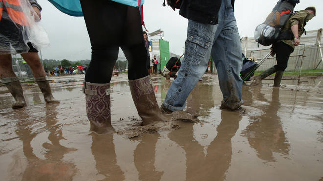 Revellers in the mud at Glastonbury Festival 2016