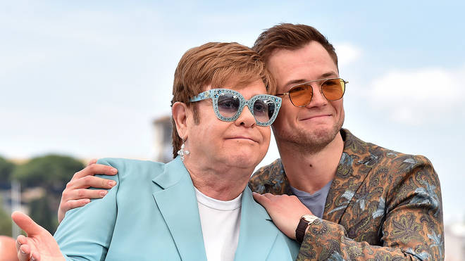 "Sir Elton John and Taron Egerton attend the photocall for ""Rocketman"""
