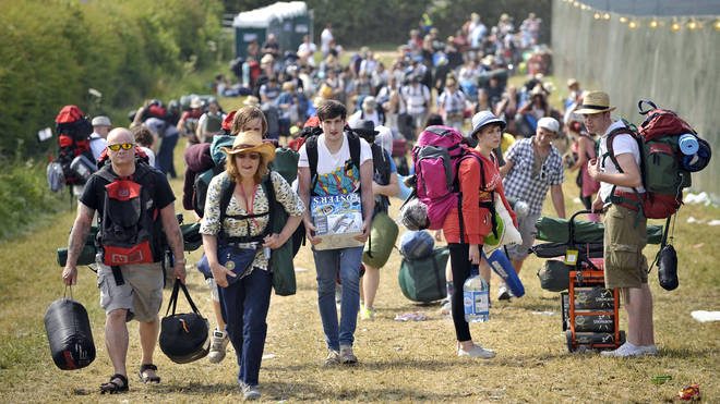 Festival goers arrive at Glastonbury in 2010