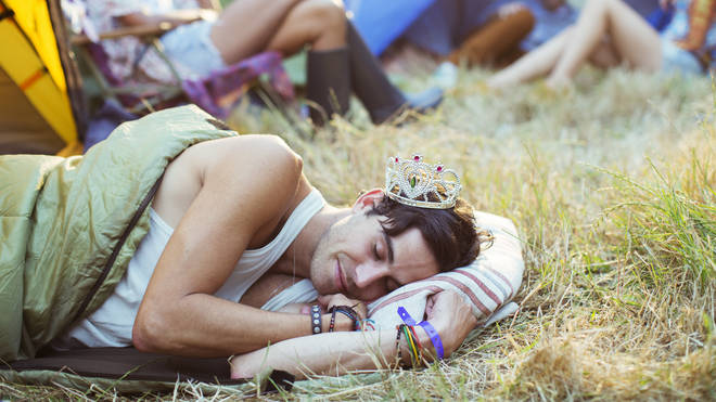 Festival goer asleep in a sleeping bag