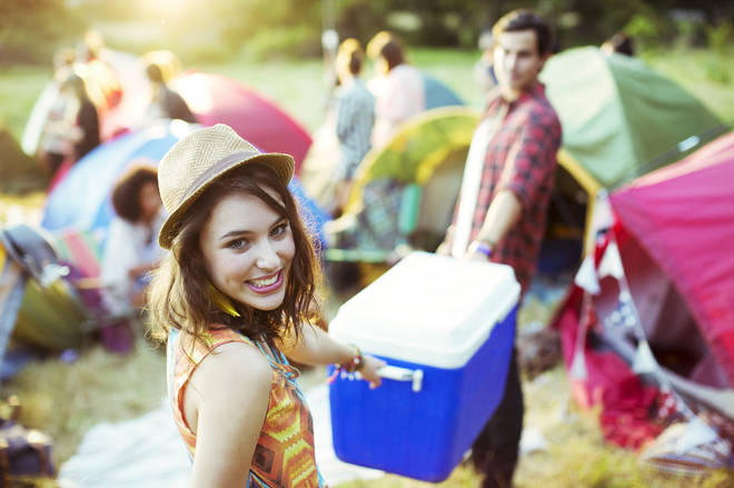 Campers with a picnic cooler. They've got the beers.