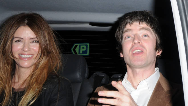 Always the passenger: Noel pictured with wife Sara in the back of acab in 2010