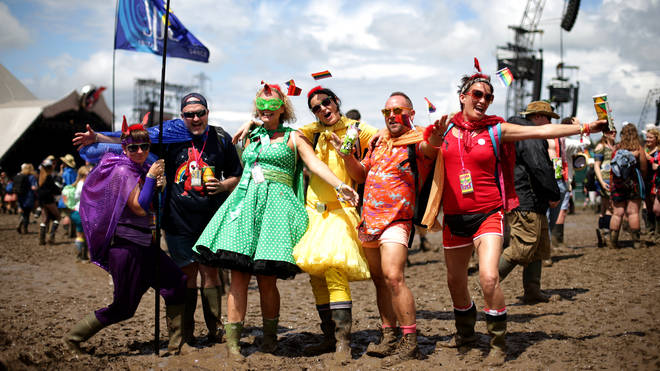 Festival-goers in fancy dress at Glastonbury