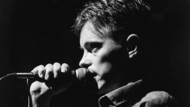 Bernard Sumner of New Order performing live in 1981