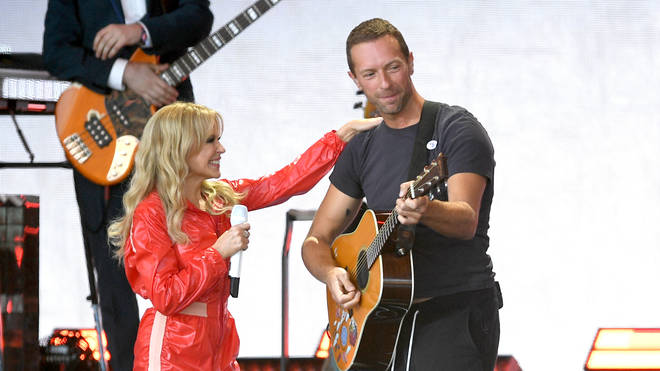 Kylie Minogue and Chris Martin perform on the Pyramid stage during day five of Glastonbury