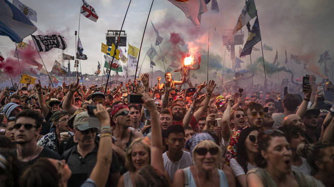 Glastonbury Festival-goers gather at the Pryramid Stage