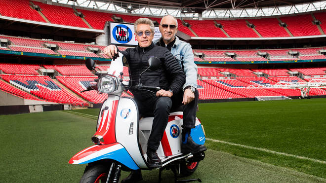The Who's Roger Daltrey and Pete Townsend pose on a scooter in Wembley Stadium