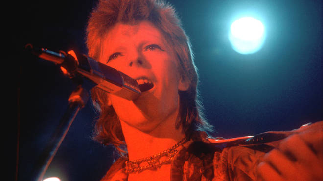 David Bowie performs onstage during his Ziggy Stardust era in 1973 in Los Angeles