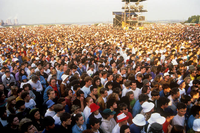 Fans wait for The Stone Roses to take to the stage at Spike Island, Widnes, 27 May 1990