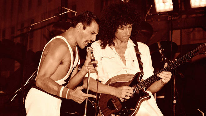 Brian May and Freddie Mercury performing live on stage