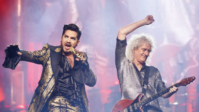 Adam Lambert and Brian May of Queen + Adam Lambert perform on stage during their Rhapsody Tour opener at Rogers Arena on July 10, 2019