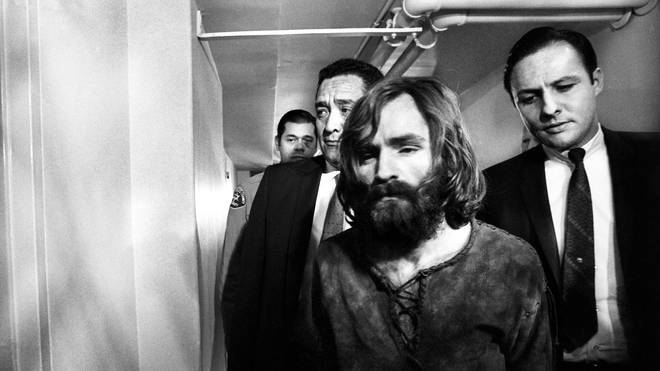 Charles Manson  leaves court after deferring a plea on the murder charges.