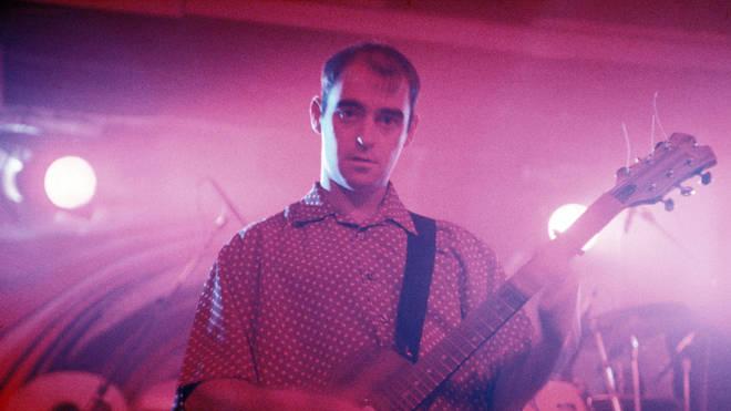 Oasis rhythm guitarist Paul 'Bonehead' Arthurs performs in January 1995