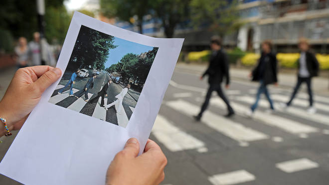 A print of the famous Abbey Road Beatles record cover is pictured at the same pedestrian crossing on Abbey Road, in north London, on August 7, 2009