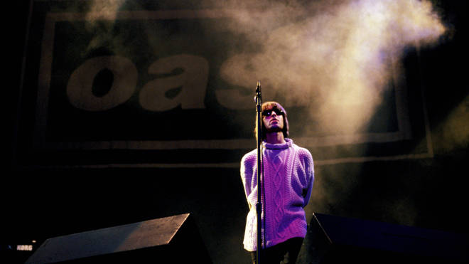 Liam Gallagher performing live onstage with Oasis at Knebworth, August 1996