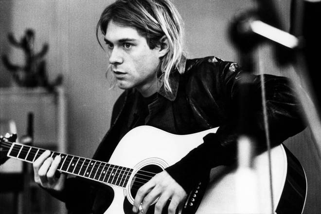 Kurt Cobain recording in Hilversum Studios, playing acoustic guitar, 1991