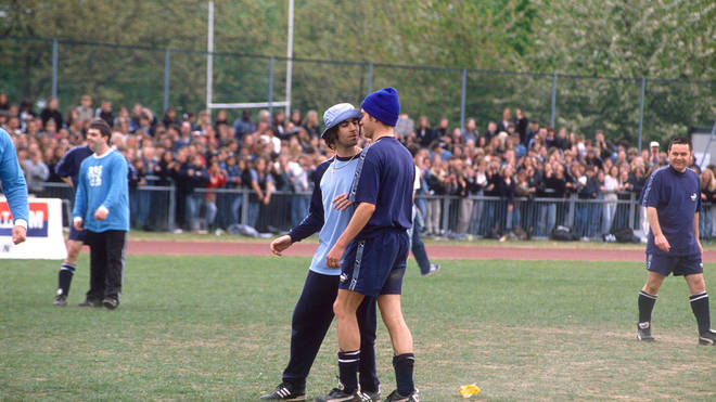 Liam Gallagher And Damon Albarn square off at a charity football match in Mile End, 15 May 1996