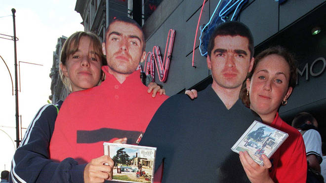 Oasis fans Nicky Strange with her friend Stephanie Cole proudly show-off their copies of the long-awaited new Oasis album Be Here Now.